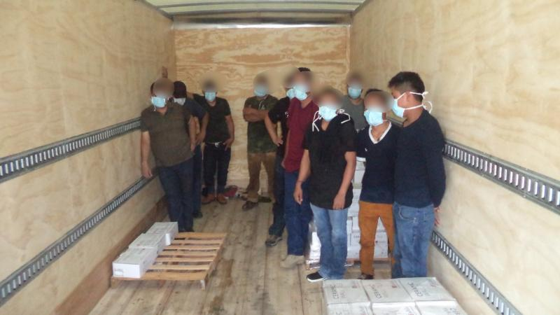 Smuggled migrants face added layers of danger in tractor-trailers