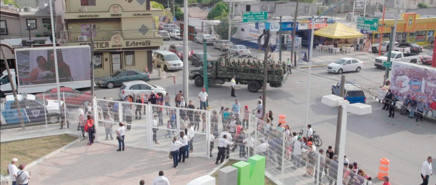 "A Mexican military truck with soldiers patrol the baseball stadium in Nuevo Laredo, Mexico, during a 2019 home game of e Tecolotes de los Dos Laredo, a binational professional baseball team with home stadiums in Nuevo Laredo and Laredo, Texas. ""Bad Hombres,"" a new Showtime sports documentary, follows this AAA Mexican League baseball team that plays on both sides of the U.S.-Mexico border amid the tension around migration, divisive politics, and environmental concerns. (Showtime via AP)"