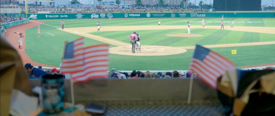 "A 2019 game of Tecolotes de los Dos Laredo, a binational professional baseball team with home stadiums in Nuevo Laredo, Mexico, and Laredo, Texas, appears in a scene from ""Bad Hombres."" The new Showtime sports documentary follows this AAA Mexican League baseball team that plays on both sides of the U.S.-Mexico border amid the tension around migration, divisive politics, and environmental concerns. (Showtime via AP)"