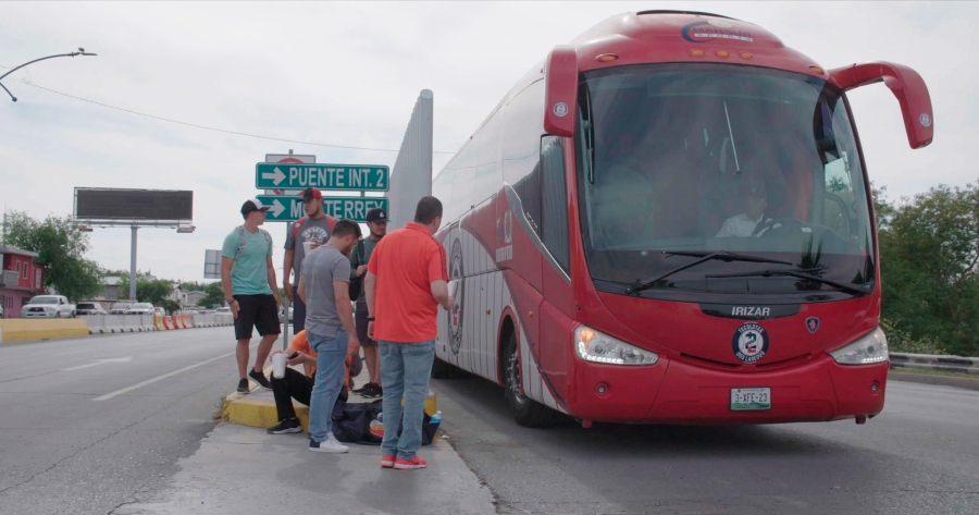 "Members of the Tecolotes de los Dos Laredo, a binational professional baseball team with home stadiums in Nuevo Laredo, Mexico, and Laredo, Texas, board a bus in Nuevo Laredo to travel to an away game during the 2019 season in a scene from ""Bad Hombres."" The new Showtime sports documentary follows this AAA Mexican League baseball team that plays on both sides of the U.S.-Mexico border amid the tension around migration, divisive politics, and environmental concerns. (Showtime via AP)"
