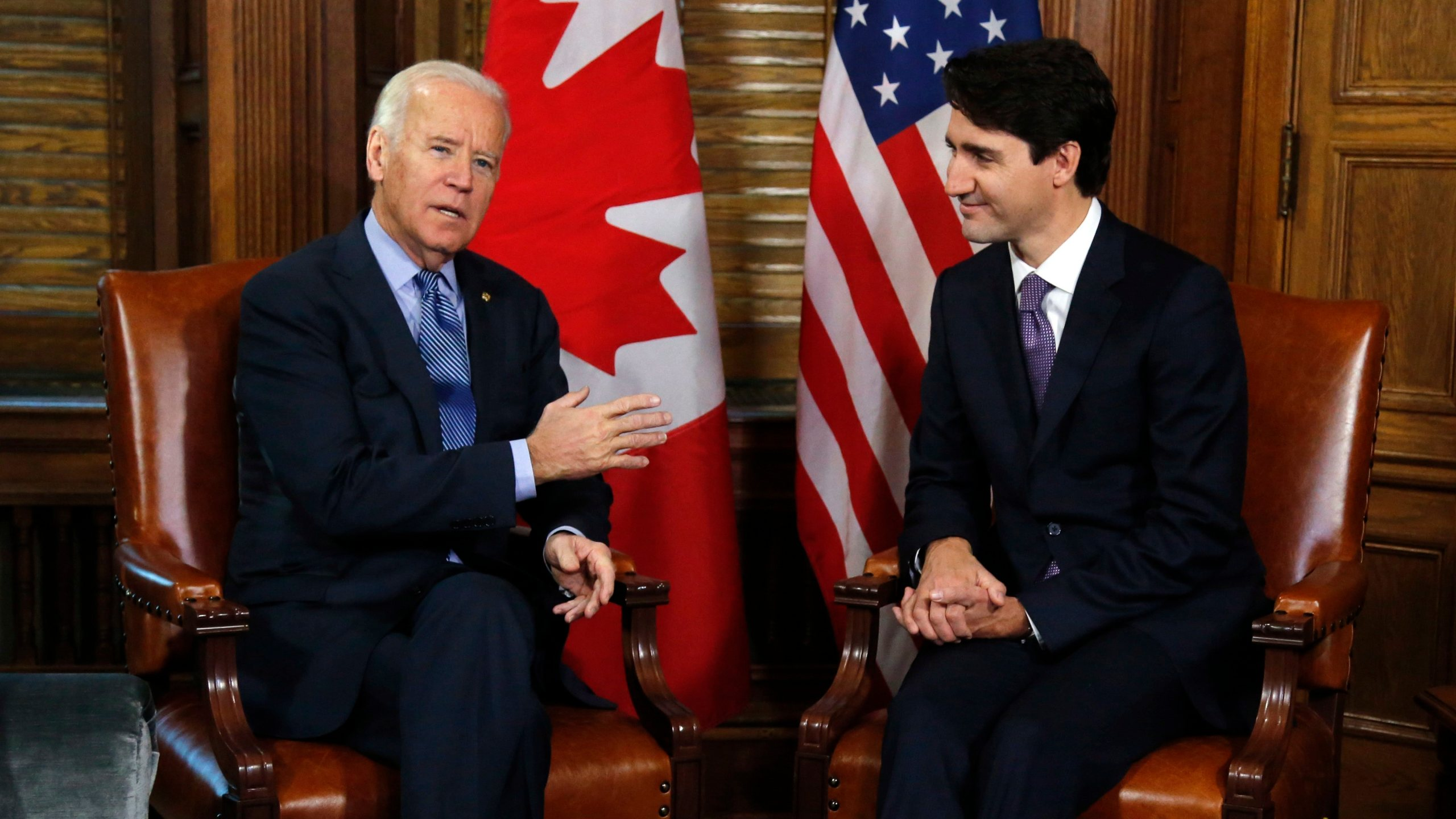 FILE - In this Dec. 9, 2016 file photo, Canadian Prime Minister Justin Trudeau meets with then U.S. Vice President Joe Biden on Parliament Hill in Ottawa. Biden will still host Canadian Prime Minister Justin Trudeau on Tuesday for the first bilateral meeting but will do it virtually. (Patrick Doyle/The Canadian Press via AP)