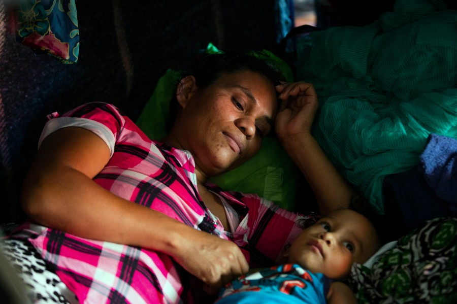 Fany Sirei, 38, from Honduras rests next to her 15-month-old child Junior Yair at a shelter, Friday, Sept. 17, 2021, in Ciudad Acuña, Mexico. Sirei has been waiting for six months in Mexico to enter the United States.(Marie D. De Jesús/Houston Chronicle via AP)