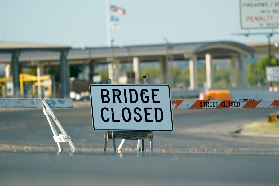 The International bridge where thousands of Haitian migrants have created a makeshift camp remains closed, Saturday, Sept. 18, 2021, in Del Rio, Texas. The Biden administration plans the widescale expulsion of Haitian migrants from a small Texas border city by putting them on on flights to Haiti starting Sunday, an official said Friday, representing a swift and dramatic response to thousands who suddenly crossed the border from Mexico and gathered under and around a bridge.(AP Photo/Eric Gay)